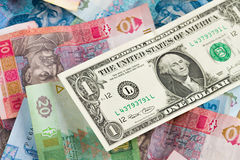 Ukrainian economic crisis: currency rate hryvnia to dollar. Currency exhange concept. American one dollar on ukrainian money background Royalty Free Stock Photography