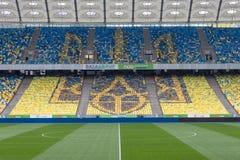 Ukrainian emblem on seats at stadium. Olimpiyskiy Stock Photo