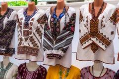 Ukrainian embroidered shirts, national handmade clothes are on sale. Ukrainian embroidered shirts, national handmade clothes are on sale with different royalty free stock image