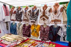 Ukrainian embroidered shirts, national handmade clothes are on sale. With different decorations stock image