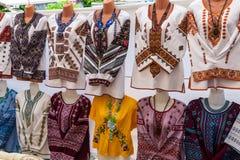 Ukrainian embroidered shirts, national handmade clothes are on sale. Ukrainian embroidered shirts, national handmade clothes are on sale with different stock photography