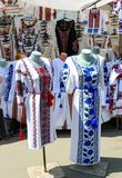 Ukrainian embroidered shirts, national handmade clothes. Traditional linen shirt with embroidered flowers and ornaments at local. Market at state fair.  Fair royalty free stock photos