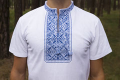 Ukrainian embroidery male closeup. Ukrainian white and blue vyshivankaka on a man closeup stock photography