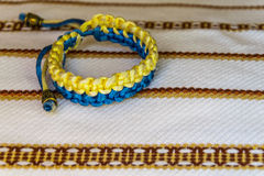 Ukrainian ethnic ornament, blue-yellow bracelet Royalty Free Stock Photo