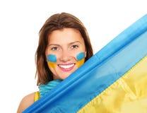 Ukrainian fan. A picture of a happy Ukrainian female fan cheering against white background Stock Photos