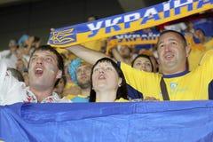 Ukrainian fans. DONETSK, UKRAINE - JUNE 19, 2012: Ukrainian fans welcome their team during match EURO 2012 Ukraine vs. England in Donetsk at Donbass Arena Stock Photos