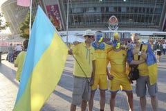 Ukrainian fans. DONETSK, UKRAINE - JUNE 19, 2012: Ukrainian fans before the match EURO 2012 Ukraine vs. England in Donetsk at Donbass Arena. They do not know Stock Photo