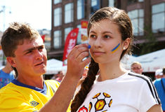 Ukrainian fans painted faces Stock Photography