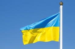 Ukrainian flag. On a background sky Stock Photos