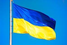 Ukrainian flag against a clear blue sky. Ukrainian flag against a blue sky. Yellow and blue colors. National symbol of Ukraine royalty free stock photo
