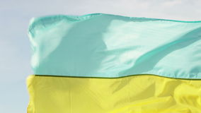 Ukrainian flag. On background of blue sky Ukrainian flag stock footage