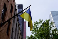 Flag of Ukraine with a black mourning ribbon. Ukrainian flag on the building Flag of Ukraine with a black mourning ribbon Royalty Free Stock Images