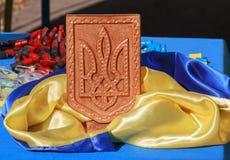 Ukrainian flag, coat of arms and machine-gun shells Royalty Free Stock Photography