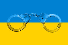 Ukrainian Flag and Handcuffs Royalty Free Stock Photos