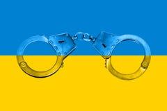 Ukrainian Flag and Handcuffs Royalty Free Stock Photos