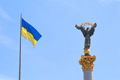 Ukrainian flag and Monument to Berehynia in Kiev Stock Photos