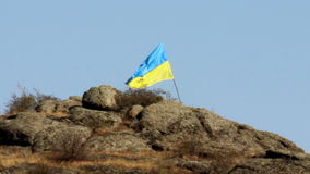 Ukrainian flag in mountain. Ukrainian flag at the Aktovskiy Canyon, Nikolaev region, Ukraine stock video