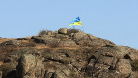 Ukrainian flag in mountain. Ukrainian flag at the Aktovskiy Canyon, Nikolaev region, Ukraine stock video footage