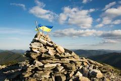Ukrainian flag on the mountain. Ukrainian flag in the Carpathian mountains Royalty Free Stock Images