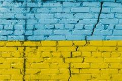 Ukrainian flag painted on a brick wall. Flag of Ukraine. Textured abstract background Stock Photos