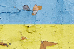Ukrainian flag painted on a brick wall. Flag of Ukraine. Textured abstract background Royalty Free Stock Image