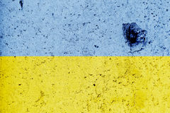 Ukrainian flag painted on a concrete wall. Flag of Ukraine. Textured abstract background Royalty Free Stock Photo