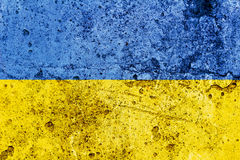 Ukrainian flag painted on a concrete wall. Flag of Ukraine. Textured abstract background Stock Images