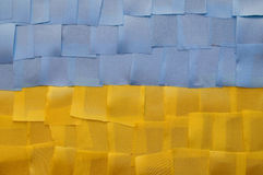 Ukrainian flag from a piece of cloth. State flag of Ukraine from a piece of cloth in the shape of a rectangle of yellow and blue color Stock Photography