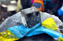 Ukrainian flag pressed to a stone Stock Photo