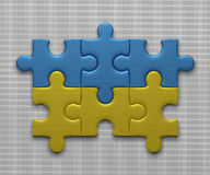 Ukrainian flag of puzzle pieces. Ukrainian flag assembled of puzzle pieces on gray background Royalty Free Stock Images