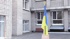 Ukrainian flag school yard. On support Ukrainian flag school yard stock footage