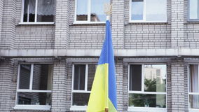 Ukrainian flag school yard. On support Ukrainian flag school yard stock video footage