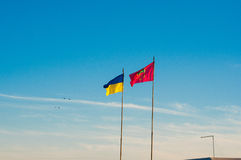 The Ukrainian flag together with the flag of the city of Zaporozhye Royalty Free Stock Images