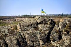 Top of canyon with flag. Ukrainian flag at the top of the Aktovskiy Canyon, Nikolaev region, Ukraine Royalty Free Stock Image