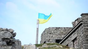 Ukrainian flag on the top of the mountain. Near the old observatory stock video footage