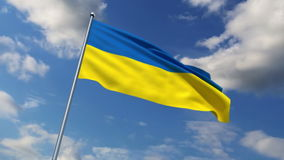 Ukrainian flag. Waving against time-lapse clouds background stock video footage