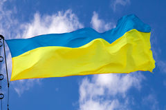 Ukrainian flag waving on cloudy sky Royalty Free Stock Photography
