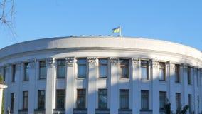 Ukrainian flag waving on top of parliament government building in Kiev - Verkhovna Rada. Supreme Council of Ukraine stock video footage