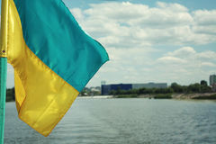 Ukrainian flag in the wind. Against the background of the sky an. D river,ukrainian national flag,National symbol of Ukraine stock photography