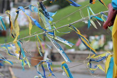 Ukrainian flags ribbons in memory of those killed  Royalty Free Stock Photos