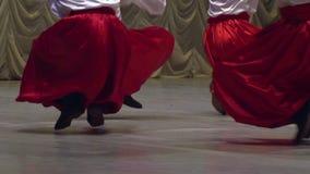 Ukrainian Folk Dance. Men in Ukrainian national dress dancing on stage. Slow Motion at a rate of 120 fps stock video footage