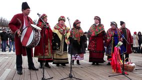 Ukrainian folk song. KIEV, UKRAINE, MARCH 6, 2011: Pancake festival. Woman in Ukrainian traditional costumes sing Ukrainian folk song. Pancake week (week before stock video footage