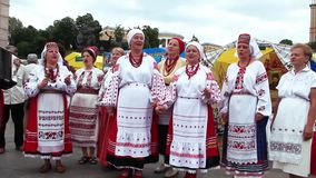 Ukrainian folk song. KIEV, UKRAINE, MAY 9, 2010: Ukrainian folk song. Woman in Ukrainian traditional costume in Kiev, Ukraine, May 9, 2010 stock video footage