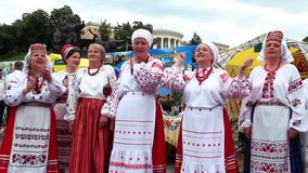 Ukrainian folk song. UKRAINE, KIEV, MAY 9, 2010: Mature women sing Ukrainian folk song on ceremonial parade dedicated to the 65th Anniversary of victory in the stock footage
