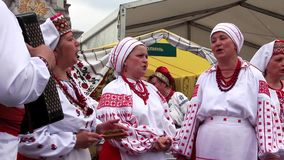 Ukrainian folk song. UKRAINE, KIEV, MAY 9, 2010: Mature women sing Ukrainian folk song on ceremonial parade dedicated to the 65th Anniversary of victory in the stock video footage