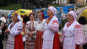Ukrainian folk song. UKRAINE, KIEV, MAY 9, 2010: Mature women sing Ukrainian folk song in ceremonial parade dedicated to the 65th Anniversary of victory in the stock video footage