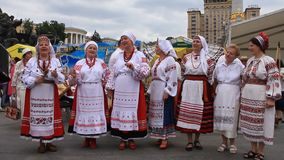 Ukrainian folk song. UKRAINE, KIEV, MAY 9, 2010: Mature women sing Ukrainian folk song in ceremonial parade dedicated to the 65th Anniversary of victory in the stock footage