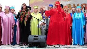 Ukrainian folk song. Women in multicoloured costume sing ukrainian song stock video