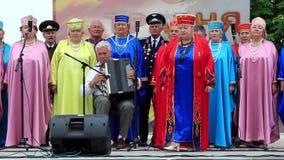 Ukrainian folk song. Women in multicoloured costume sing ukrainian song stock video