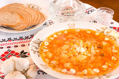 Ukrainian food - borsch, vodka, bread Stock Image